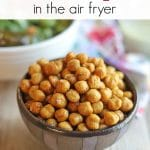 Text overlay: Fried chickpeas in the air fryer. Bowl of roasted garbanzo beans on table.