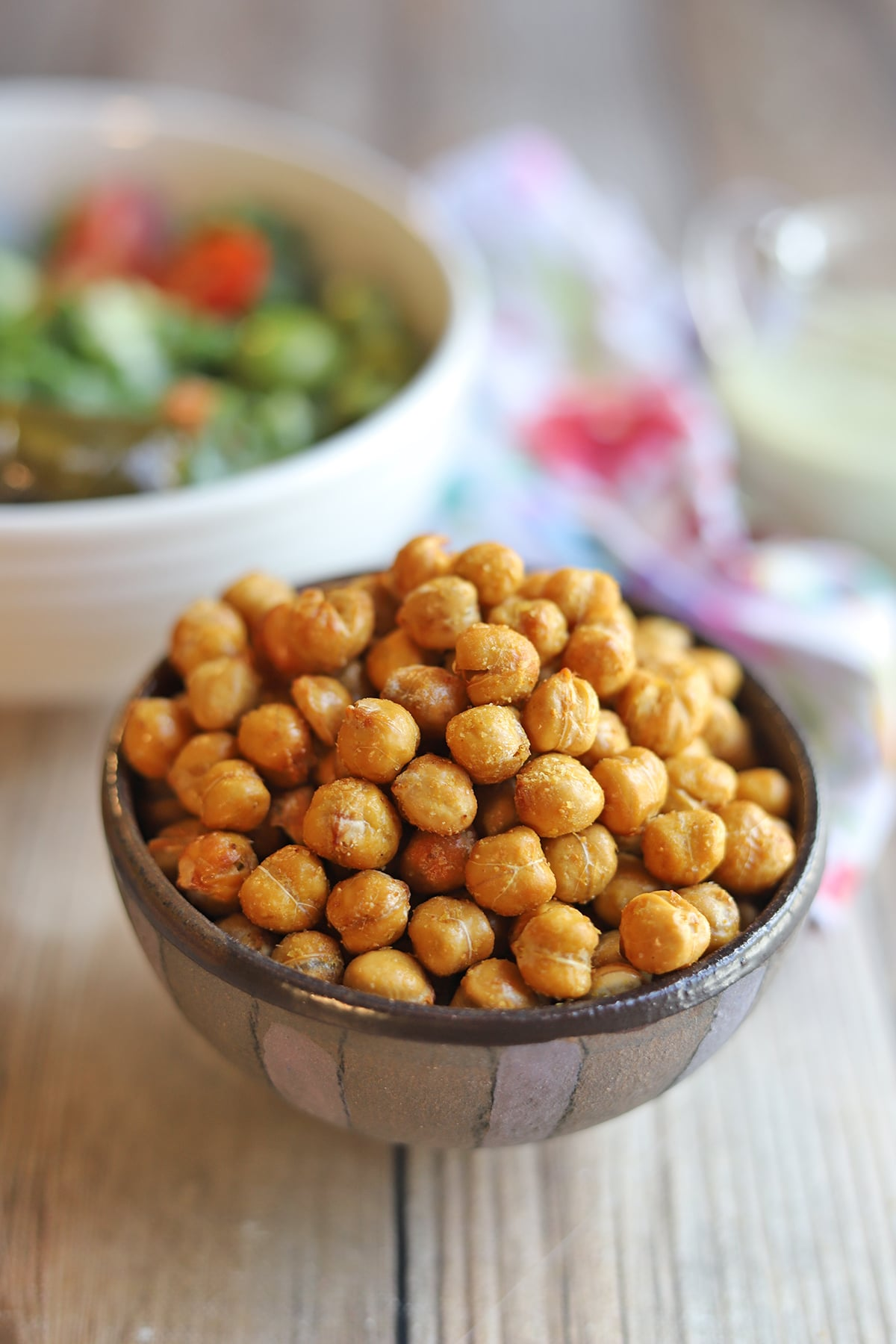 Fried chickpeas in bowl on table.