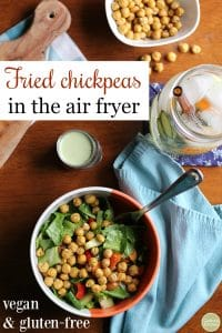 Text: Fried chickpeas in the air fryer. Vegan and gluten-free. Overhead salad with fried chickpeas, water, and blue napkin.
