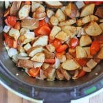 Text overlay: Air fryer breakfast potatoes. Roasted potatoes, peppers, and onions in air fryer basket.