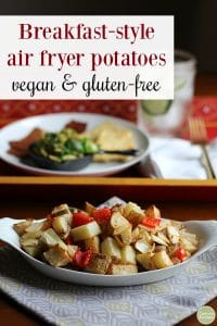 Text: Breakfast-style air fryer potatoes. Vegan and gluten-free. White dish with potatoes, bell peppers, and onions.
