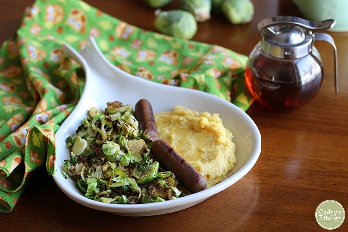 Calling savory breakfast lovers! This protein-packed breakfast will really stick with you. Creamy polenta, Brussels sprouts, and vegan sausages. Just add a drizzle of maple syrup! | cadryskitchen.com