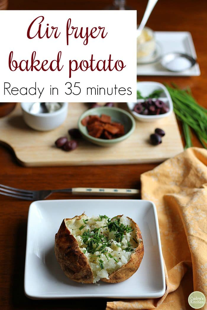 Text: Air fryer baked potato. Ready in 35 minutes. Baked potato on plate with chives.