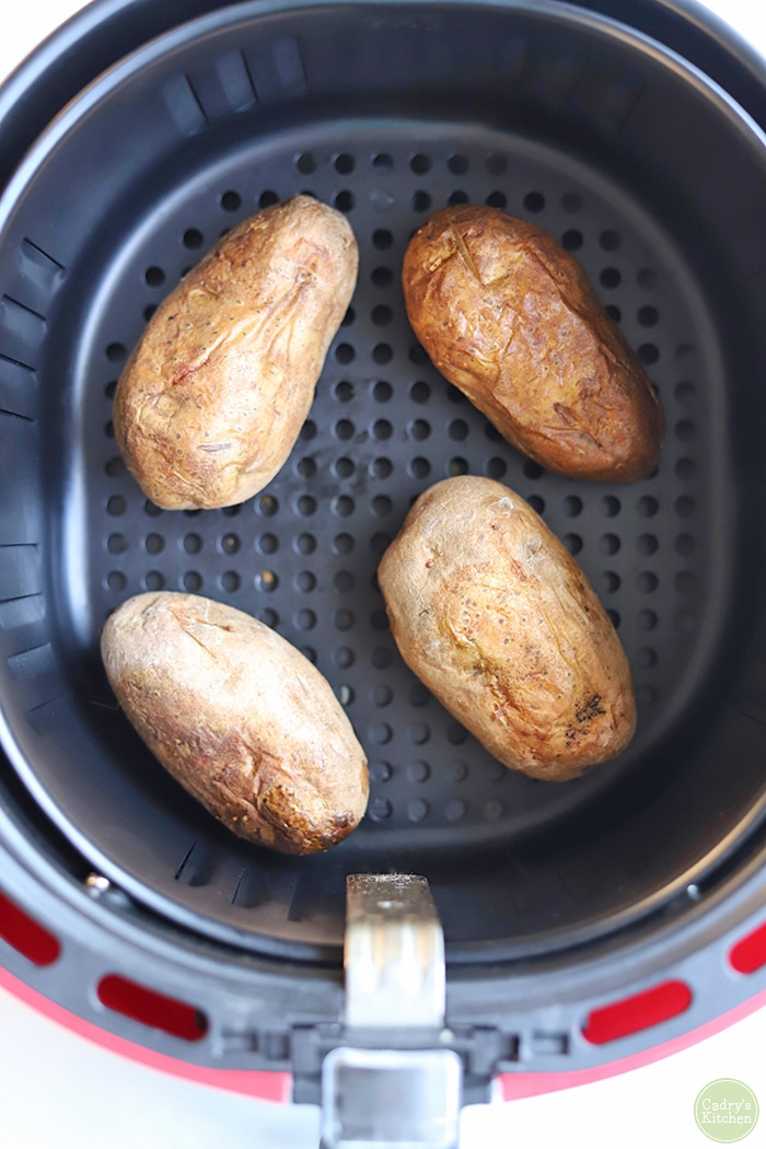 Russet potatoes in air fryer basket.