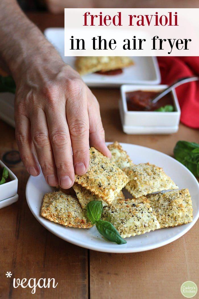 Vegan air fryer ravioli with marinara dipping sauce.