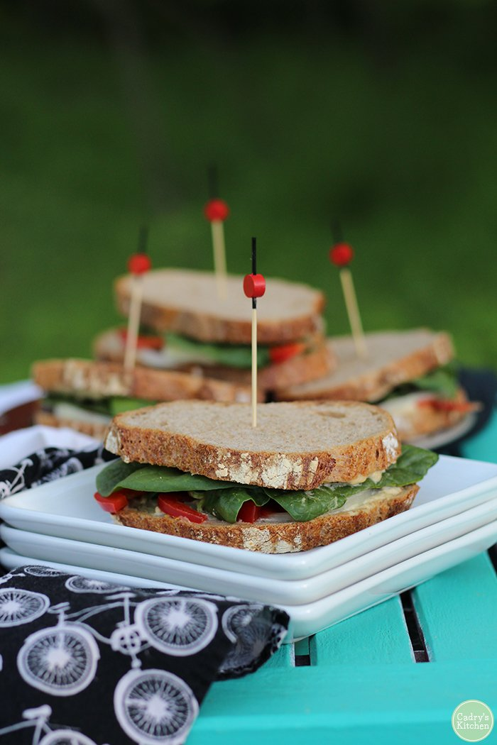 Sandwiches with jalapeno cashew cheese spread & raw vegetables. Perfect for a summer outing! | cadryskitchen.com