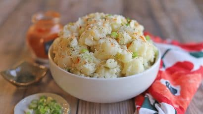 Bowl of potato salad by floral napkin.