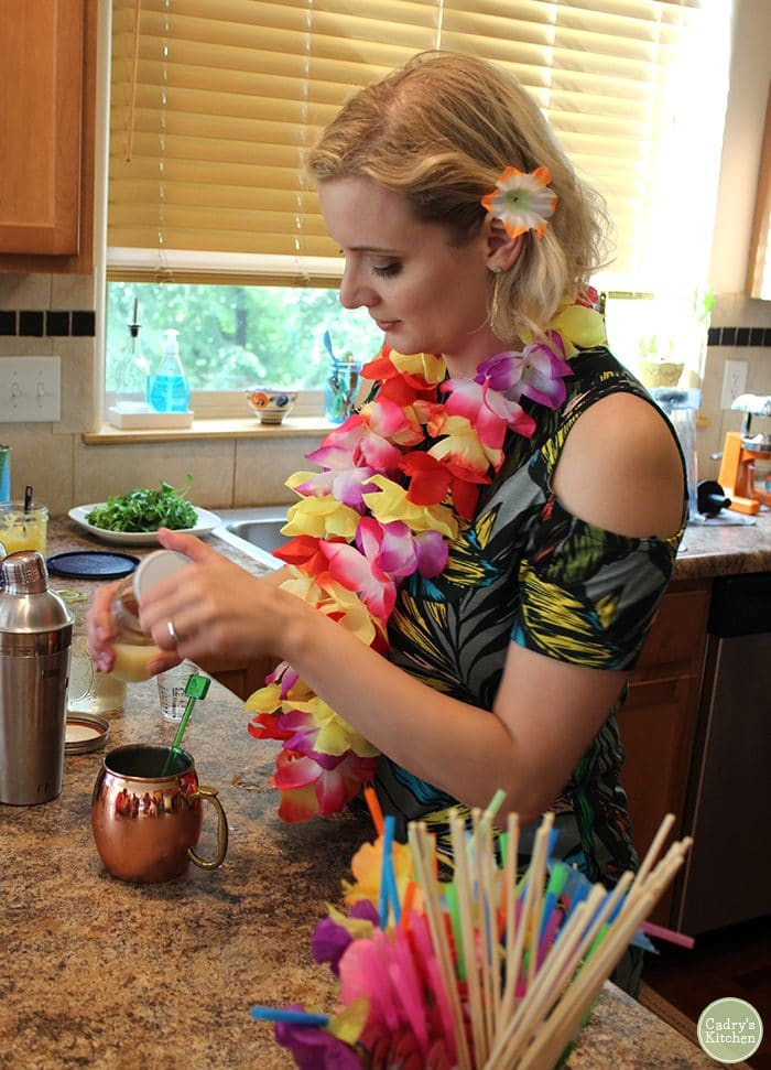 Ashley making tropical cocktails with Moscow mule mug.