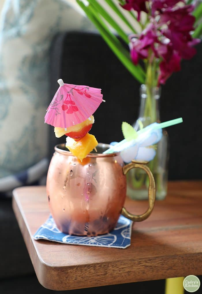 Moscow mule mug with fruit skewer & parasol.
