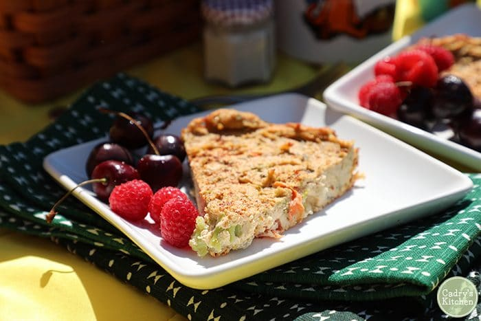 Close up picture of vegan quiche with cherries and raspberries.