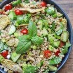 Text overlay: Israeli couscous salad. Overhead bowl of couscous salad.