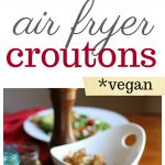 Air fryer croutons on a salad with avocado and lemon tahini dressing.