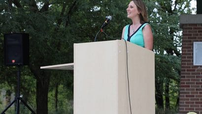 Cadry Nelson standing at podium at the Iowa VegFest.