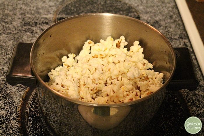 Popcorn in a pot on the stove.