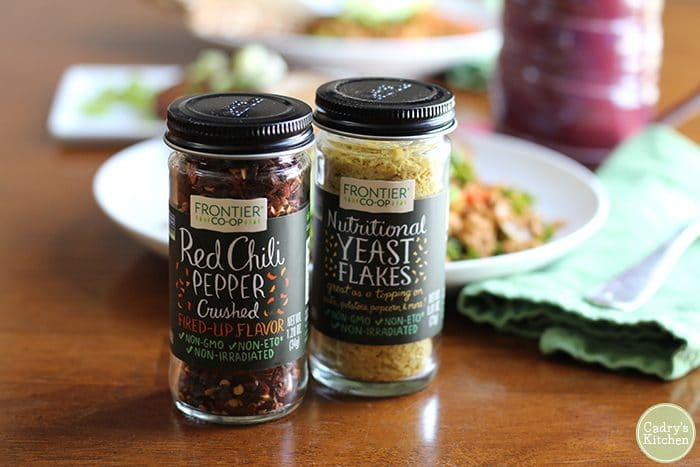 Bottles of red chili pepper flakes and nutritional yeast flakes from Frontier Co-op.