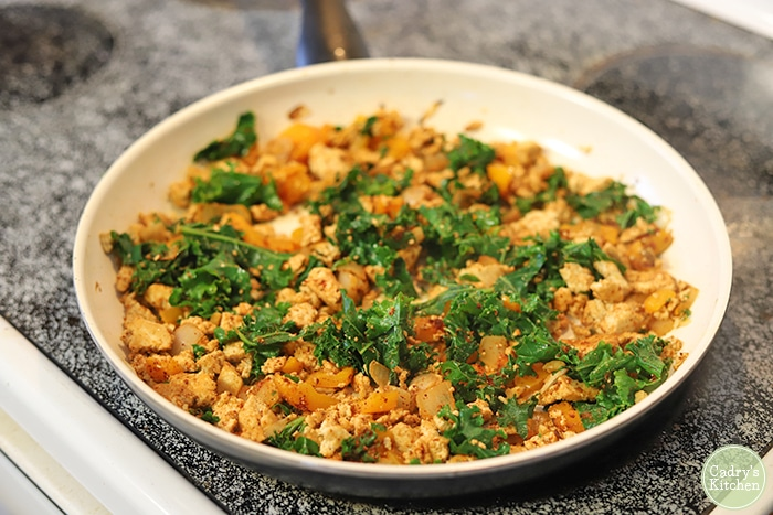 Skillet with tofu, kale, onions, and bell pepeprs.