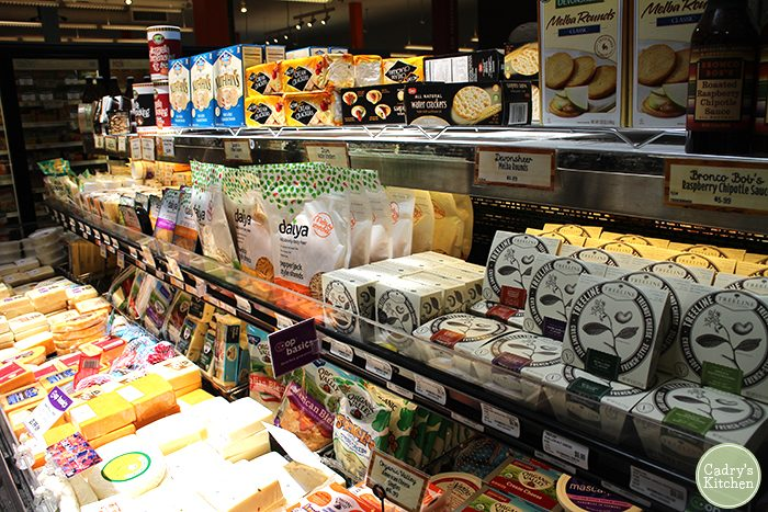 Cheese case at Wheatsville Co-op in Austin, Texas with vegan cheeses.