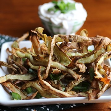 Plate of air fried potato peels with non-dairy cream cheese.
