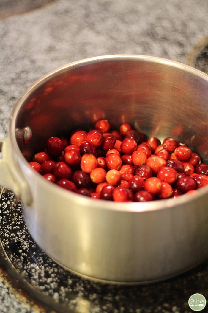 Whole cranberries in pot on stove.