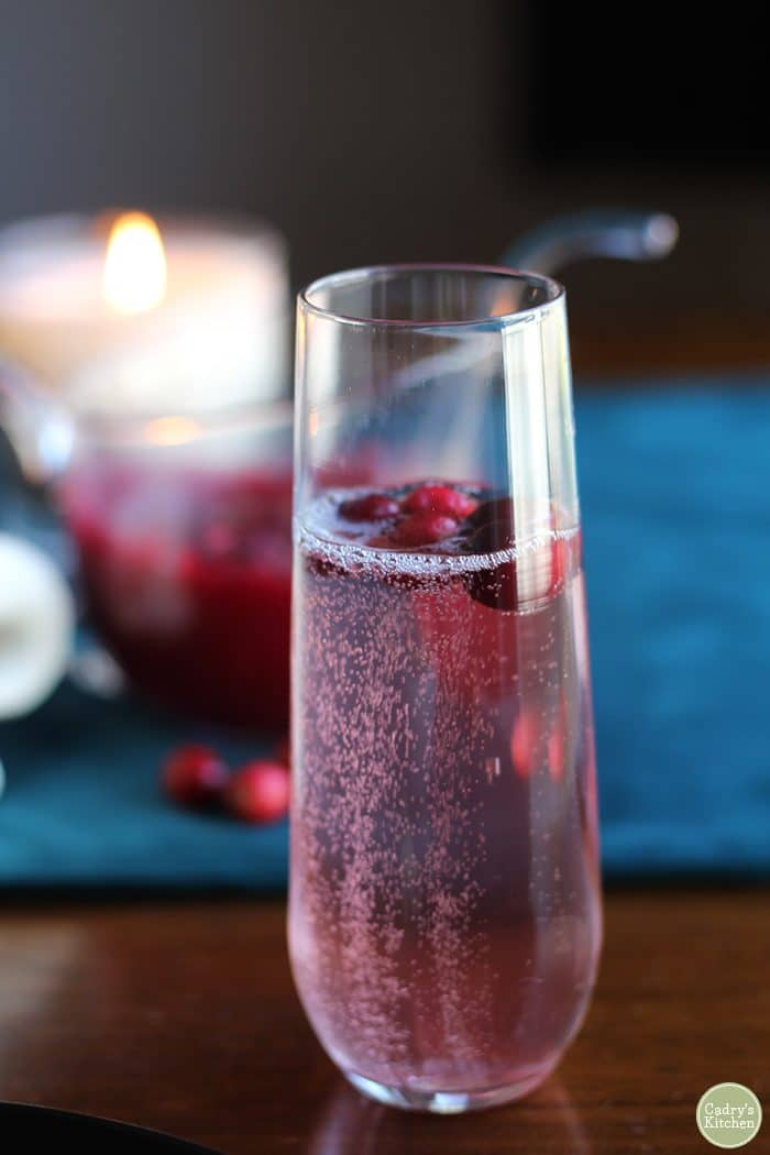 Cranberry champagne cocktail in stemless champagne flute.