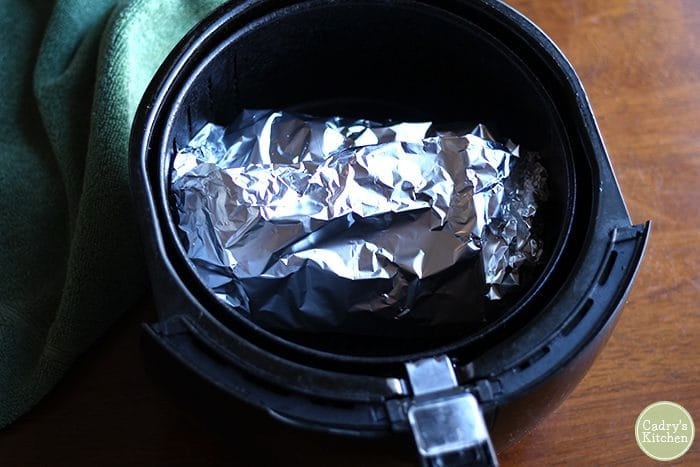 Trader Joe's turkey-less roast wrapped in aluminum foil in air fryer.