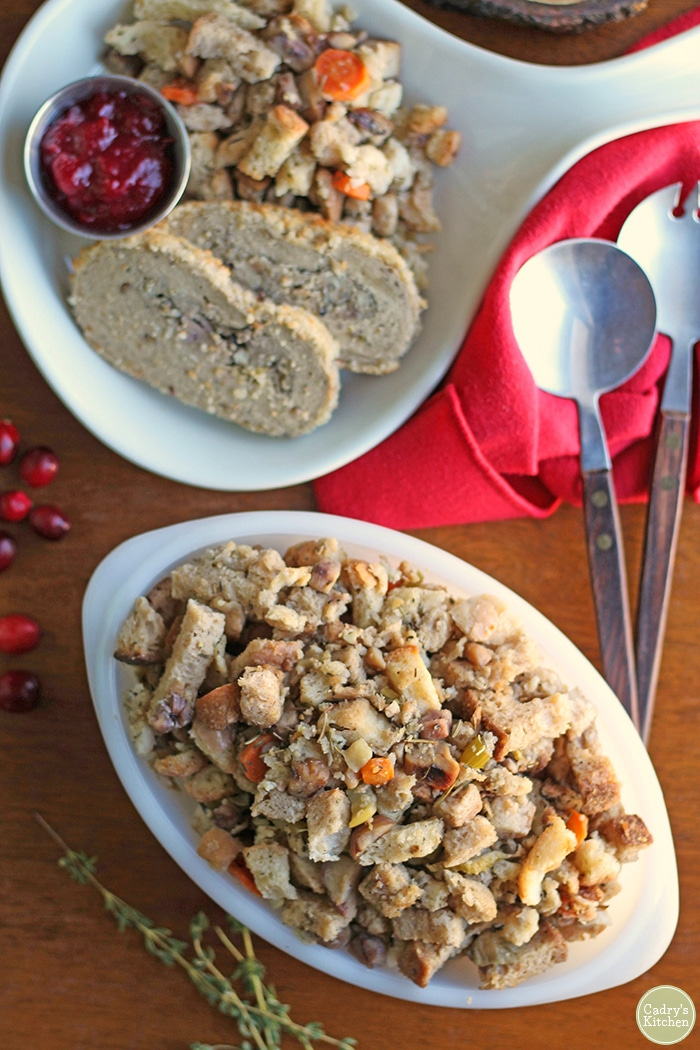 Vegan stuffing in Pyrex. Trader Joe's turkeyless roast and Christmas dinner side dishes on plate.