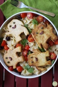 Adipose shaped tofu from Doctor Who on top of bowtie pasta salad.