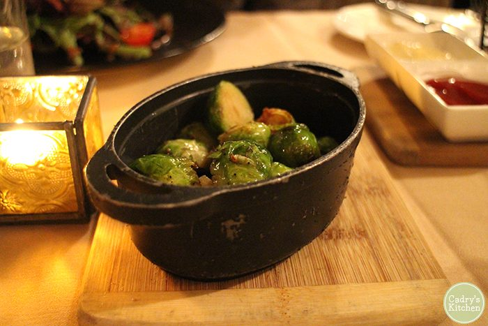 Brussels sprouts in black casserole dish at Cedar Restaurant.
