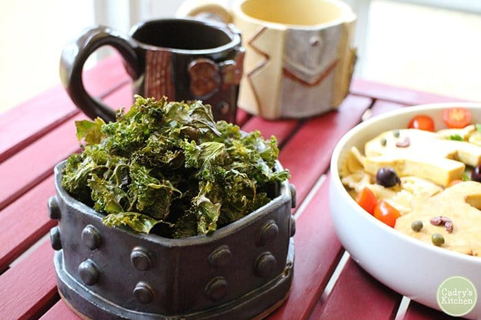 Kale chips in Dalek bowl with Doctor Who handmade mugs in background.