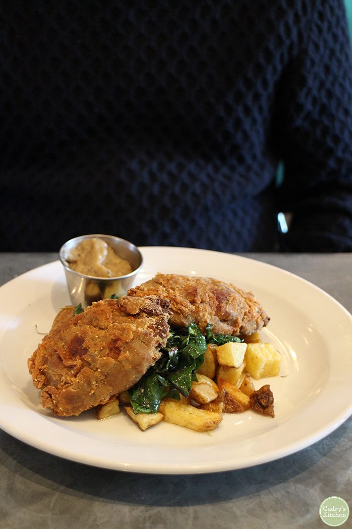Fried seitan platter with Swiss chard and potatoes at Fare Well.