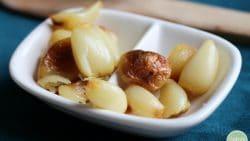 Roasted garlic air fryer recipe. Roasted garlic in dish.