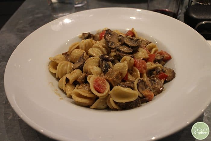 Pasta with mushrooms on plate at Fare Well in Washington, D.C.