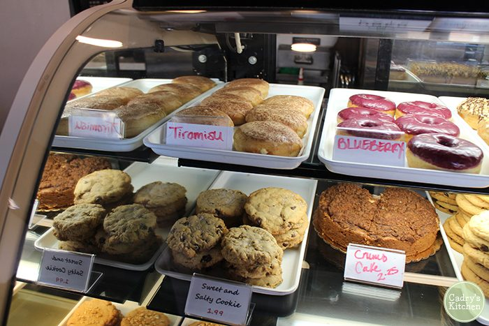 Vegan donuts, cookies, and cake in display case at Sticky Fingers Bakery.