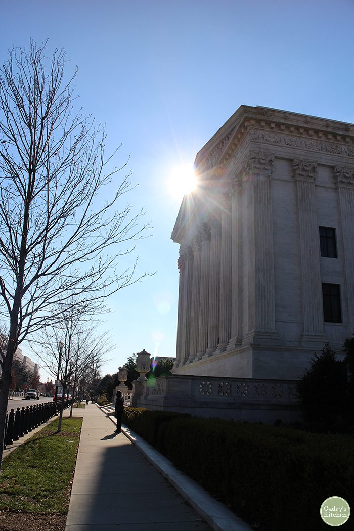 Supreme Court with sun shining on it in Washington, D.C.
