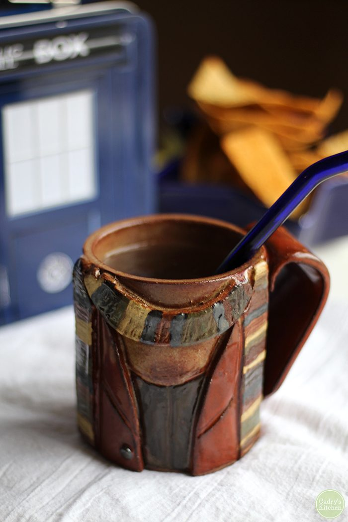 Tom Baker themed mug with multicolored scarf.