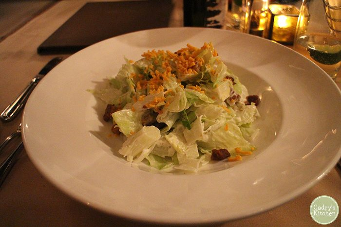 Iceberg lettuce salad with vegan cheese and tempeh bacon at Cedar Restaurant in Washington, D.C.