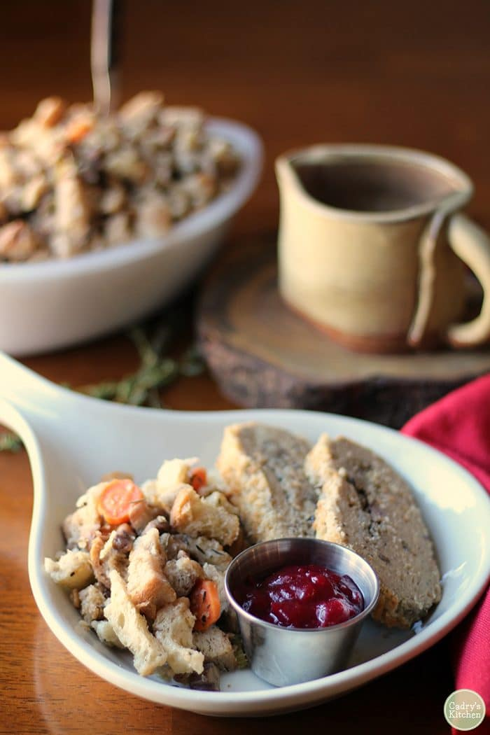 Vegan stuffing on plate with Trader Joe's turkey-less roast and cranberry sauce.