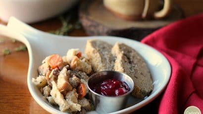 Vegan stuffing on plate with cranberry sauce and vegan roast.