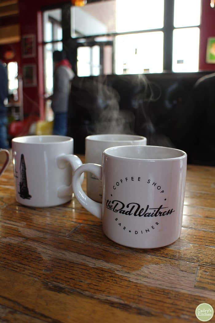 Steaming coffee mugs at The Bad Waitress Bar & Diner in Minneapolis.