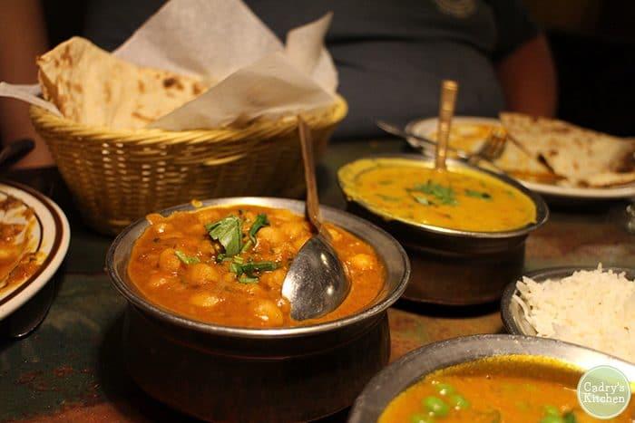 Chickpea & lentil curries with tandoori roti.