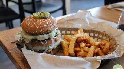 Vegan restaurants Minneapolis & St. Paul. Vegan Big Mac (The Dirty Secret) with fries in basket.