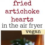 Hand dipping fried artichoke heart into vegan aioli. Platter of fried artichoke hearts made in the air fryer. Text.