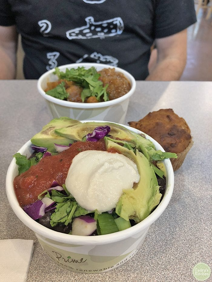 No Coast bowl at The Full Bowl. Black beans and rice bowl with salsa and vegan sour cream.