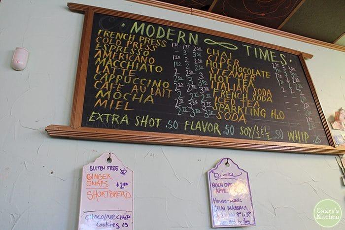 Handwritten chalkboard menu on wall.