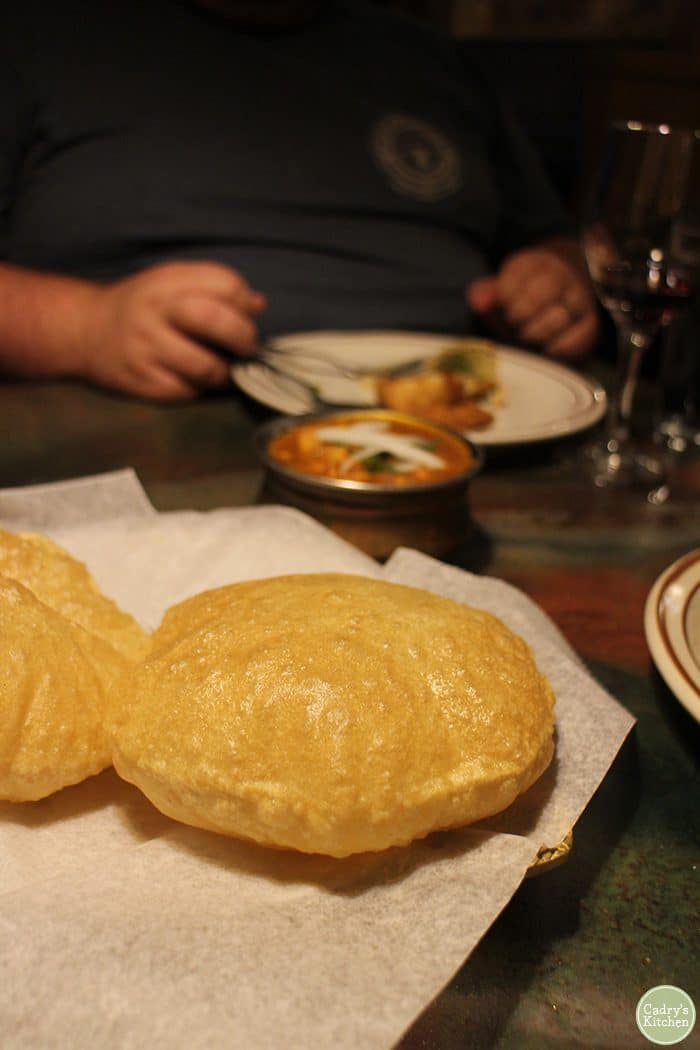 Poori, puffy Indian bread, on a plate at Taste of India in Cedar Rapids.
