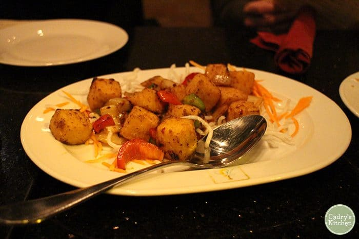 Salt and pepper tofu on plate with spoon at Jasmine 26.