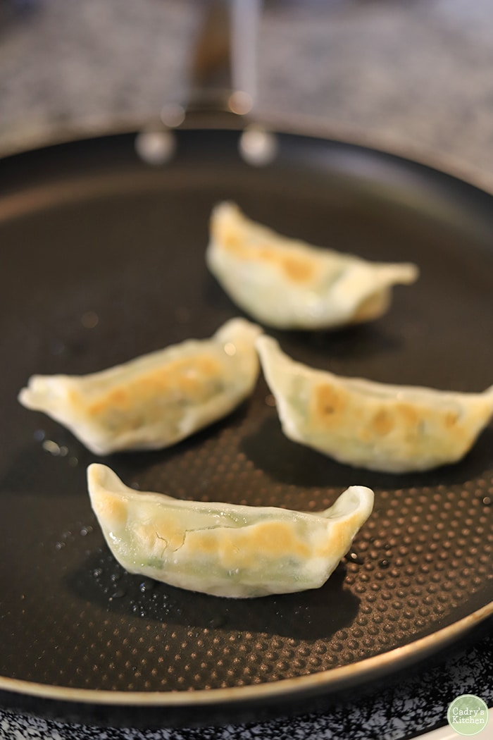 Trader Joe's Thai vegetable gyoza cooking in skillet.