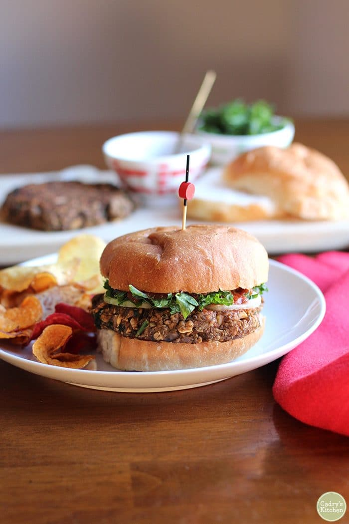 Vegan lentil burgers with chips.