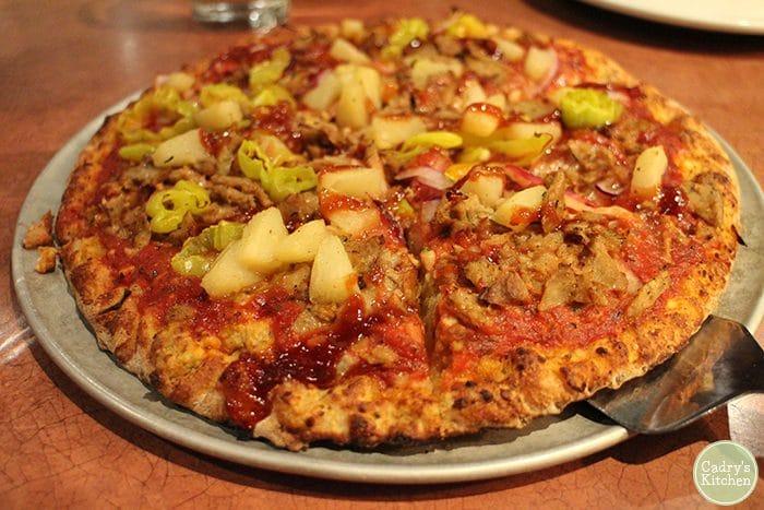 Vegan pizza on pie pan at Pizza Luce.