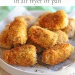 Text overlay: Fried artichoke hearts in air fryer or pan. Breaded hearts on plate.